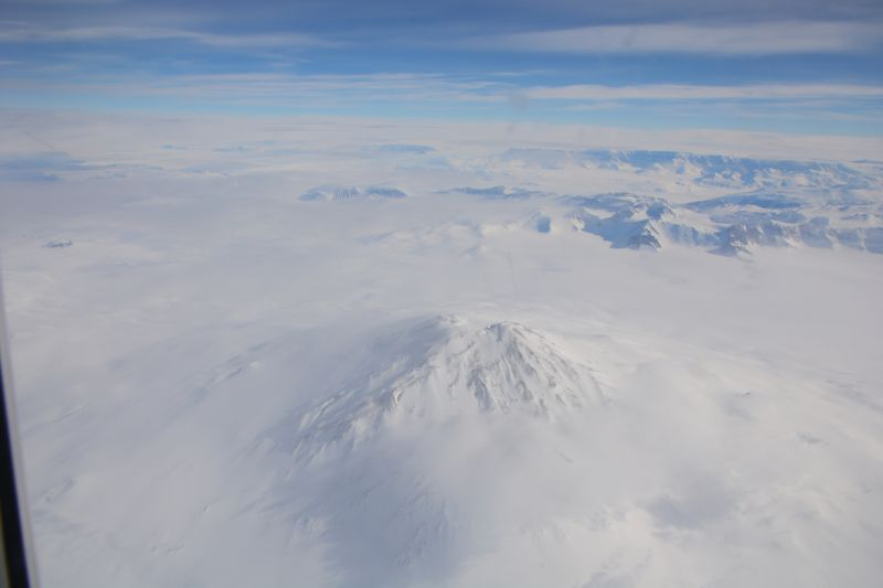 View of a volcano from an aeroplane window