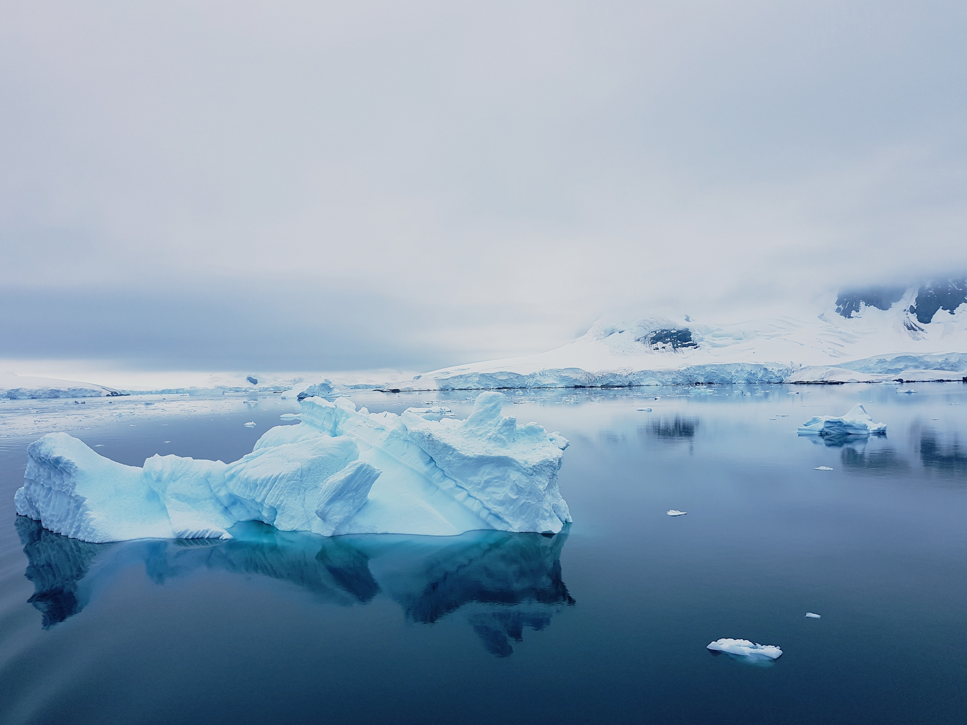 flat sea with floating ice