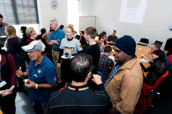 Indigenous rangers and University of Melbourne academic staff mingle at a workshop.