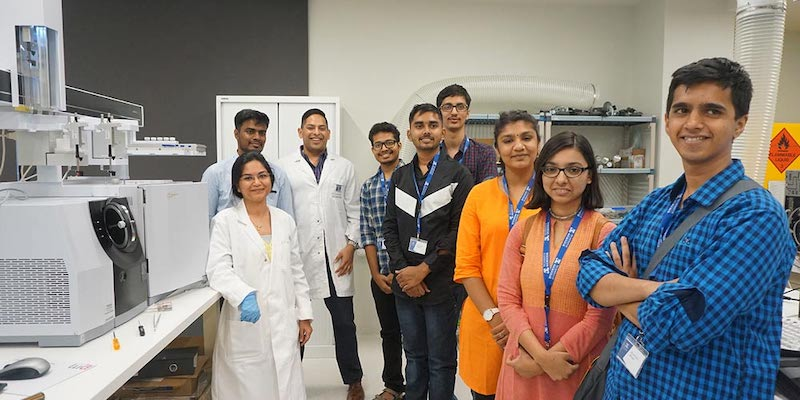 A group of BSc (Blended) students posing in a Bio21 Institute laboratory