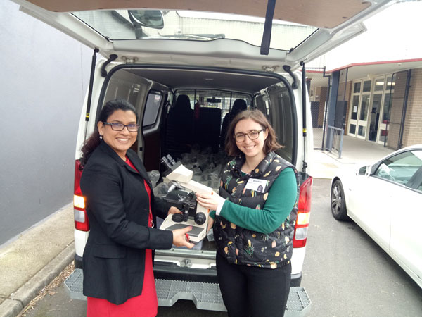 University of Melbourne donated 65 microscopes to In2Science Schools. Pictures is In2Science coordinator Madeleine Yewers (University of Melbourne) and Thomastown Science Coordinator Julie George