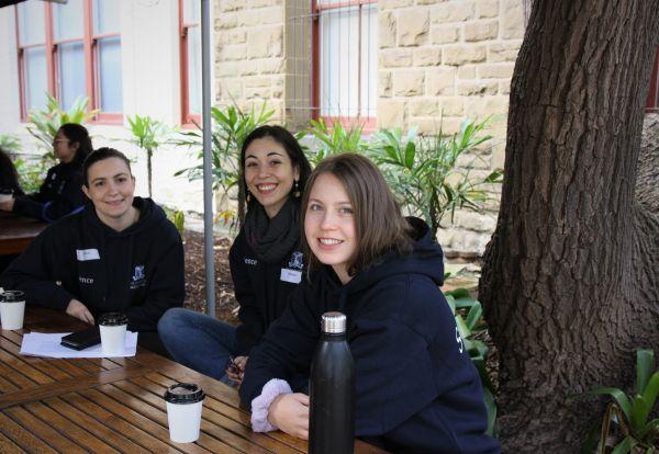 three students in science hoodies