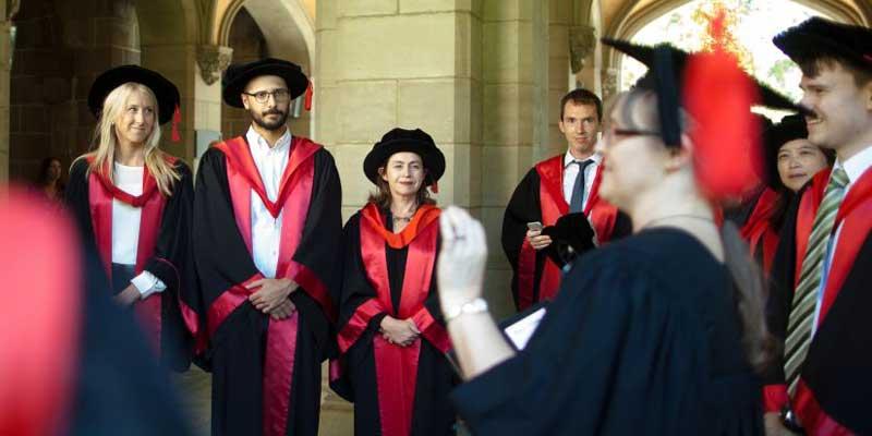 PhD graduands, in full regalia, awaiting their graduation ceremony