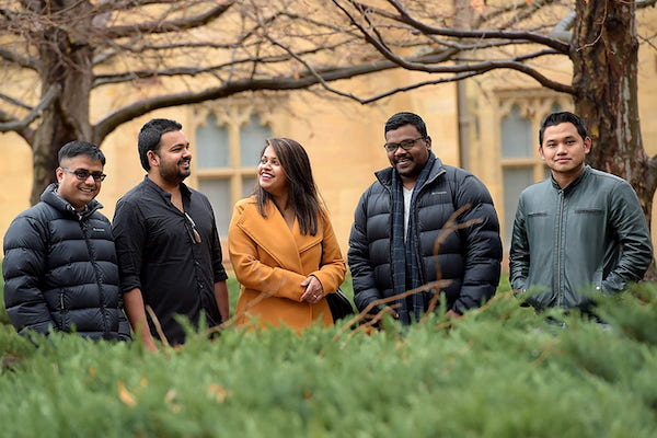 Five students from the MIPP, on the grounds of our Parkville campus