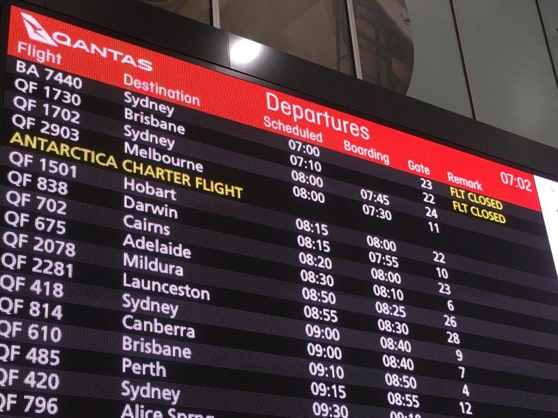 Airport departure board showing Antarctica charter flight