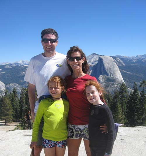 Gerald Wluka and his family stand on top of a mountain in the Yosemite National Park