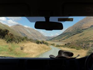 View of Nea Zealand scenery from the windshield of a car