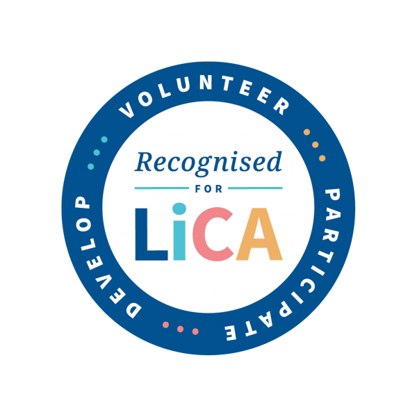 "A badge with a blue ring, titled ""Recognised for LICA"", with volunteer, participate and develop on the ring of the badge."