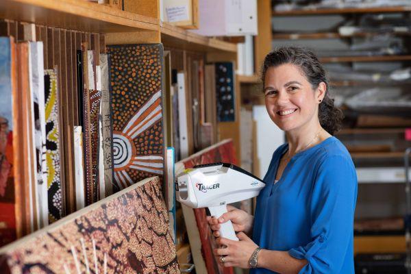Rachel Popelka Filcoff scanning books