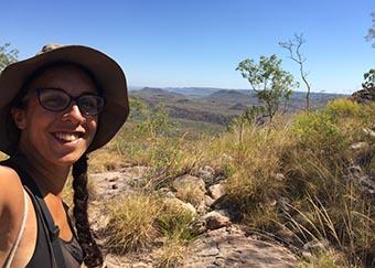 Ana Leitão posing for a selfie in the Australian bush